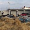 Localizan lote lleno de autos presuntamente robados