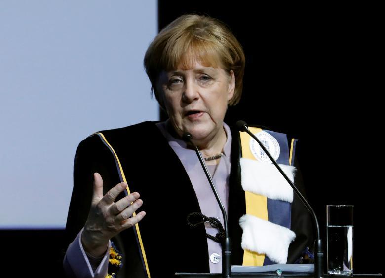 German Chancellor Angela Merkel addresses a speech after receiving a degree Honoris Causa, or honorary doctorate, from Belgian universities of KU Leuven and UGent